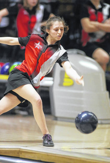 Lee Woolery|Miami Valley Today Troy's Cassidy McMullen bowls against Piqua during the Trojans final match of the regular season Thursday at Troy Bowl.
