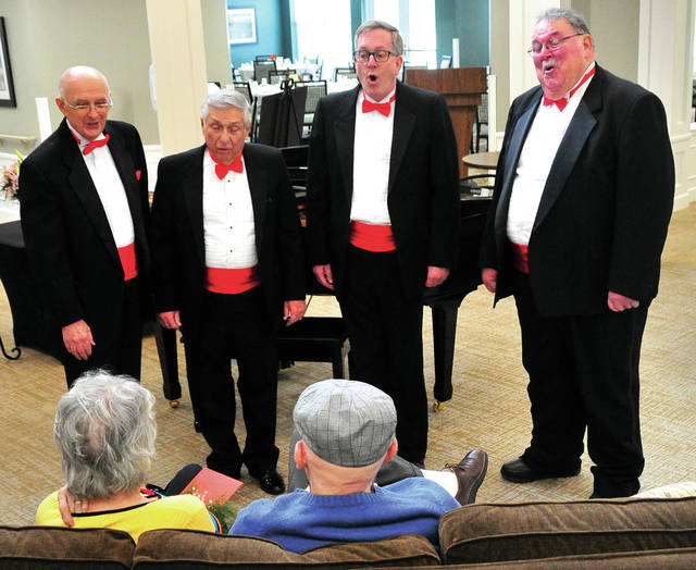 Mike Ullery | Miami Valley Today The Melody Men, including Dale McKinney, Ron Ventura, Mark Reedy, and Gary Roeth, deliver a special Valentine's Day greeting to Story Pointe residents Dick and Bev Votau on Thursday. Story Pointe was just one of a number of singing valentine stops made by the quartet on during this annual event.