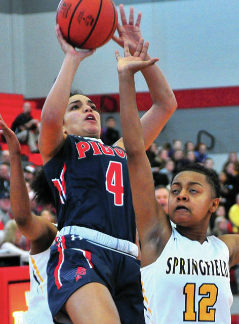 Tylah Yeomans, 4, scores in spite of a Springfield double team