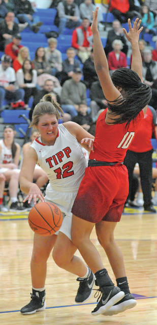 Josh Brown|Miami Valley Today Tippecanoe's Brooke Aselage works in the paint against a Trotwood defender during a Division II sectional tournament game Tuesday at Springfield High School.