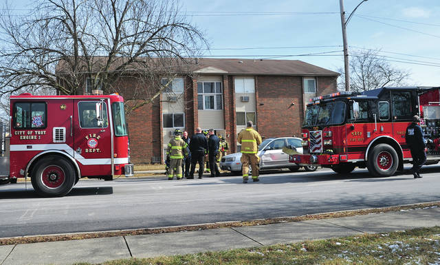 Troy firefighters work at the scene of an apartment fire on Crescent Drive on Tuesday.
