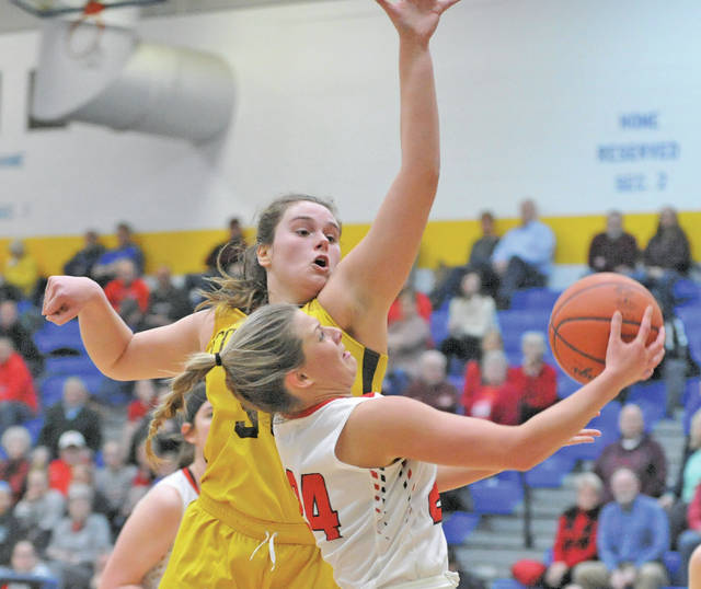 Josh Brown|Miami Valley Today Tippecanoe's Kendall Clodfelter goes in for a layup as Kenton Ridge's Mikala Morris defends during Monday's Division II sectional final at Springfield High School.