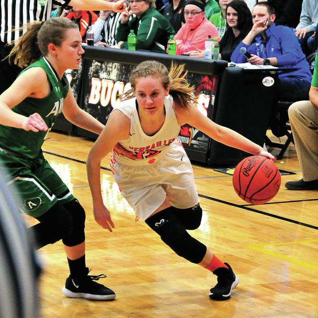 Versailles' Catlin McEldowney drives to the hoop against Anna Monday night at Covington High School.