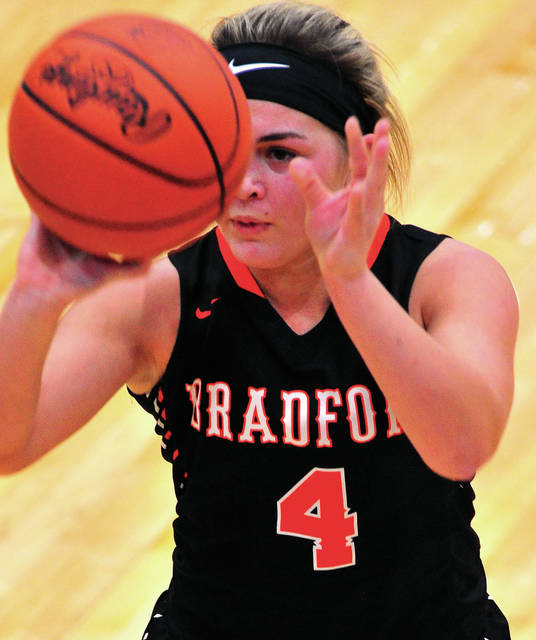 Bradford's Austy Miller lines up a shot against Tri-Village Wednesday at Brookville High School.