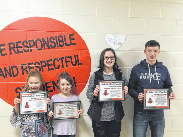 Sam Wildow | Miami Valley Today The Bradford Board of Education honored four students during their student spotlight on Monday evening: left to right, Fiona Brewer, Kendall Koether, Olivia Daugherty, and Aidan Beachler.