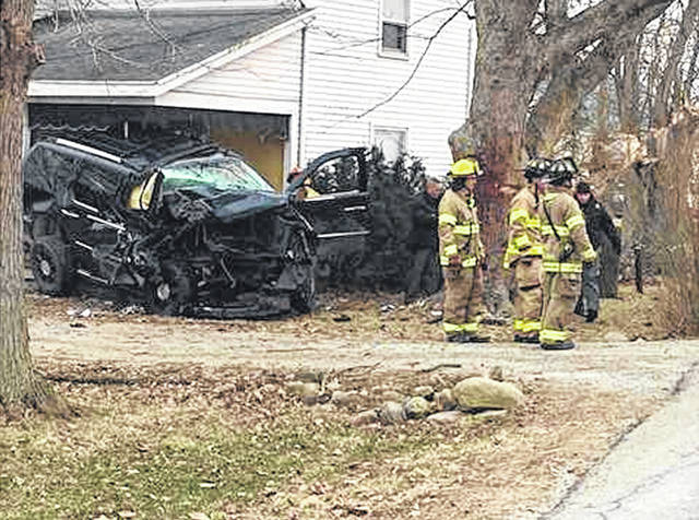 A 2007 Cadillac Escalade crashed into a house on State Route 718 between Troy and Pleasant Hill on Thursday morning. The driver was trapped in the vehicle for several hours and suffered from internal injuries and hypothermia.