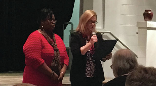 Sam Wildow | Miami Valley Today City of Piqua Mayor Kazy Hinds, right, presents Edison State Community College Diversity Committee Chairperson Marva Archibald with a proclamation honoring Black History Month on Wednesday evening.