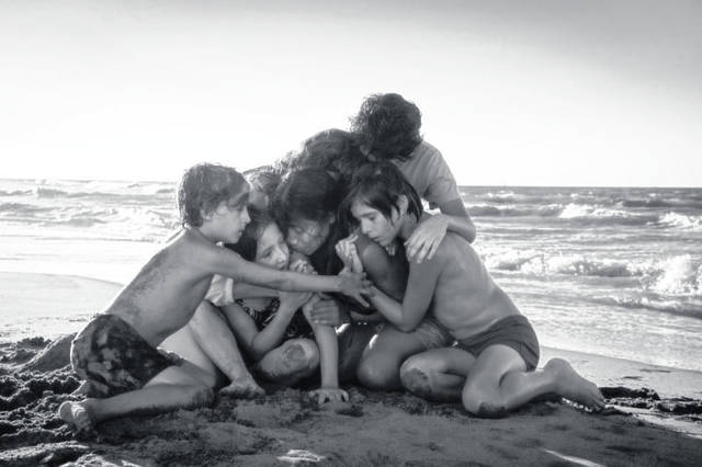 "Provided photo A middle-class Mexican family embraces in ""Roma."""