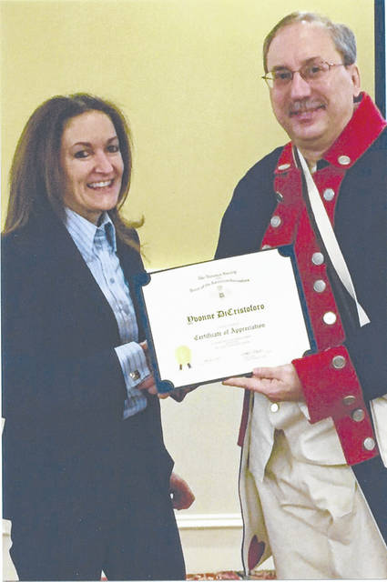 Pictured is Yvonne DiCristoforo of the US Secret Service receiving appreciation from Richard Montgomery SAR Chapter President Steve Kaplan of Troy.