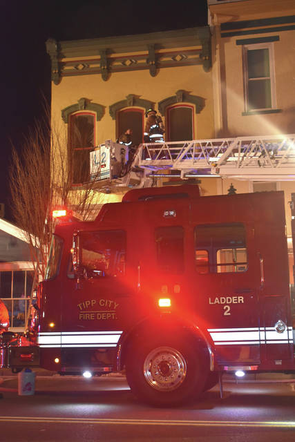 Cody Willoughby | Troy Daily News Crews work to extinguish a fire at Living Simply Soap in downtown Tipp City. The fire started early Tuesday morning, fire officials are unsure what started it.