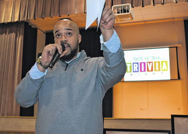Cody Willoughby | AIM Media Midwest Emcee Dewayne Williams welcomes participants to the second annual Taste of Troy Trivia Night on Friday at St. Patrick Parish Center.