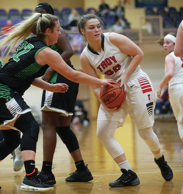 Lee Woolery|Miami Valley Sunday News Troy's Payton Riley battles with Northmont's Gabby Kline for a loose ball during a Division I sectional matchup Saturday at Butler High School.