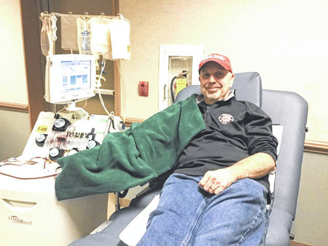 Provided photo Covington donor Rike Miller made his 100th lifetime donation at the Feb. 11 Covington Eagles blood drive.