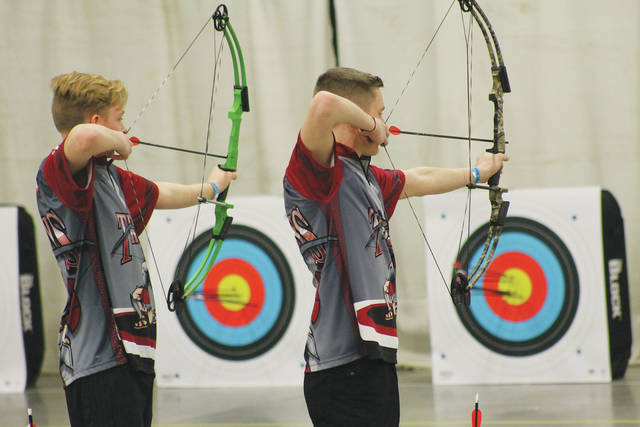 Photos courtesy of Delaney Fields Troy High School archers Jonny Micholas (left) and Nic Matthews line up their shots during the state competition.