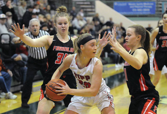 Josh Brown|Miami Valley Today Tippecanoe's Ashleigh Mader looks to pass out of a Franklin double-team Friday during the Division II district final at Mason Middle School.
