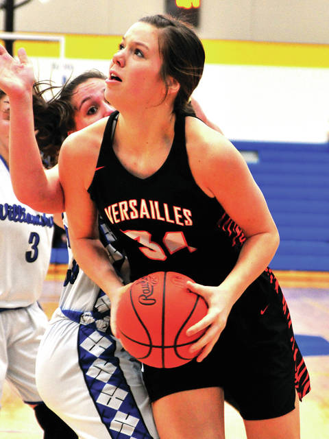 Versailles' Brooke Stonebreaker makes her way to the basket Saturday against Williamsburg.