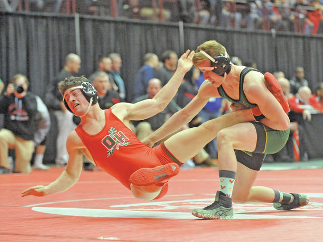Josh Brown|Miami Valley Today Troy Christian's Ethan Turner takes down Oak Harbor's Cameron Dickman during a championship semifinal match at the Division III state tournament Friday at the Schottenstein Center.