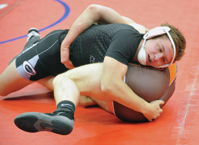 Josh Brown|Miami Valley Today Covington's Keringten Martin controls Nelsonville-York's Noah Inboden during the third-place finals match at the Division III state tournament Saturday at the Schottenstein Center.