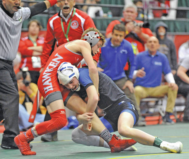 Josh Brown|Miami Valley Today Miami East's Olivia Shore scores a takedown late in the second period to tie her second round consolation match against Gates Mills Hawken's Patrick Reineke at the Division III state tournament Friday at the Schottenstein Center.