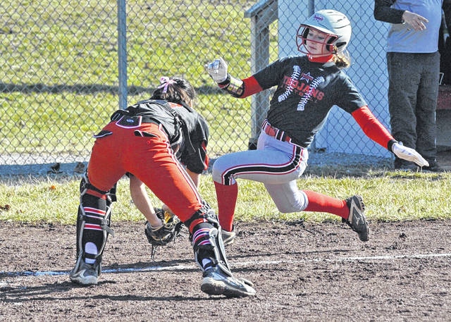 Josh Brown|Miami Valley Sunday News Troy's Bri Lavender is tagged out by Milton-Union catcher Audrey Smith after trying to score an inside-the-park home run in the first inning Saturday at Market Street Diamond.
