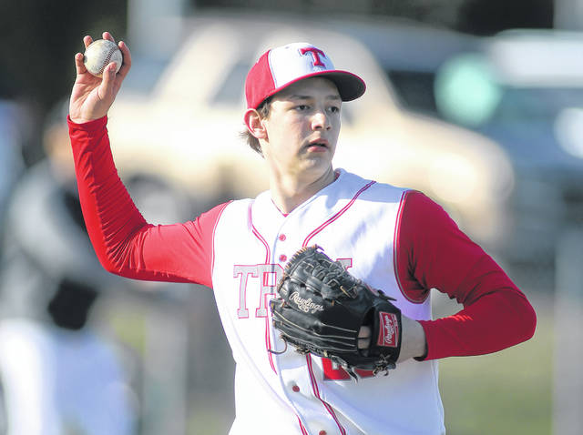 Lee Woolery|Miami Valley Today Troy starting pitcher Ethan West fields a bunt Wednesday against Wayne. West threw a complete-game four-hit shutout in Troy's 13-0 victory.