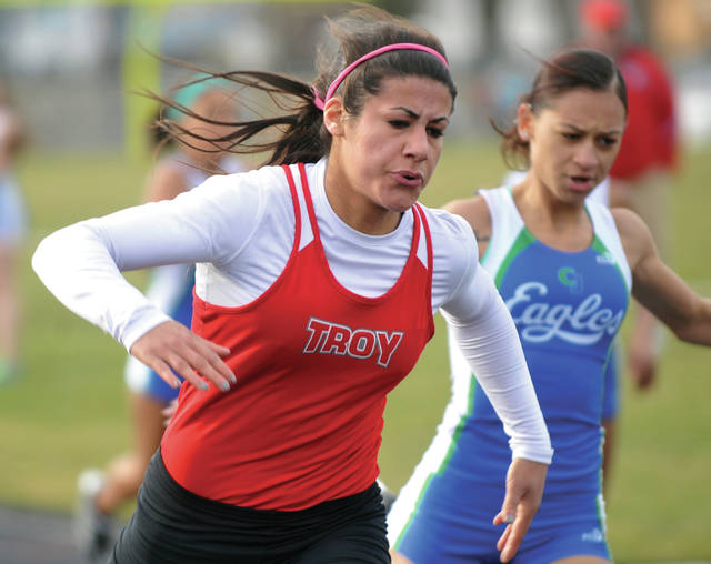 Miami Valley Today file photo Troy High School graduate Gracie Huffman, shown here winning a race in 2015, is one of the top athletes in Troy girls track and field history. Troy will celebrate the program's 100th anniversary Saturday at the Up and Running Invitational.