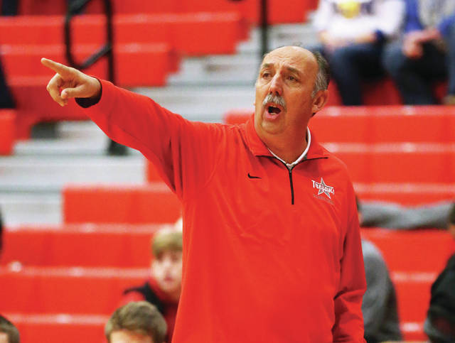Lee Woolery|Miami Valley Today file Troy boys basketball coach Paul Bremigan gives directions during the 2017-18 season opener against St. Marys at the Trojan Activities Center. After four years as the team's coach, Bremigan is stepping down, he announced on Monday.