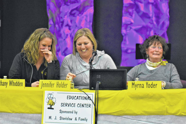 Cody Willoughby | AIM Media Midwest From left, Bethany Whidden, Jennifer Holden, and Myrna Yoder, of Miami County Educational Service Center, score the winning word during the 25th annual Corporate Spelling Bee for Literacy on Thursday at Troy Church of the Nazarene.