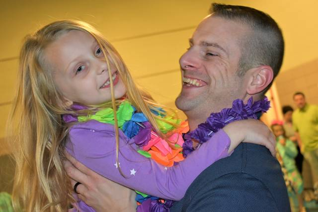 Cody Willoughby Kindergartner Sophia Asbury dances with Andy Asbury during the father/daughter, mother/son dance on Thursday at Cookson Elementary.