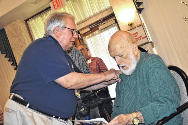 Cody Willoughby | Miami Valley Today SpringMeade resident and Army veteran Charles Hensley receives a flag pin in honor of his years of service during the American Pride ceremony on Friday at SpringMeade Health Center.