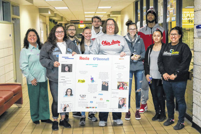 Courtesy photo Students in April Schmidlapp's class stand with a poster that was created as part of the Women's History Month Poster Sessions.