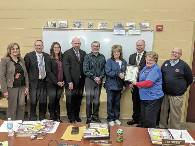 Cecilia Fox | Miami Valley Sunday News The Milton-Union Board of Education, Lori Ginn Parsons, Ben Dehus, Doug Thompson, Jessica Brumbaugh and Chris Long, pictured with Treasurer Kay Altenburger and Superintendent Brad Ritchey, accepted an award from OSBA representatives Linda Jordan and Ron Diver.