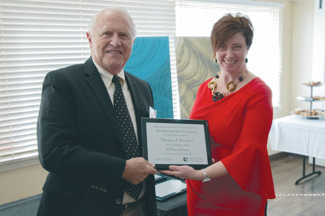 Provided photo  Thomas J. Buecker is pictured with OSBA CEO and Executive Director Mary Amos Augsburger.