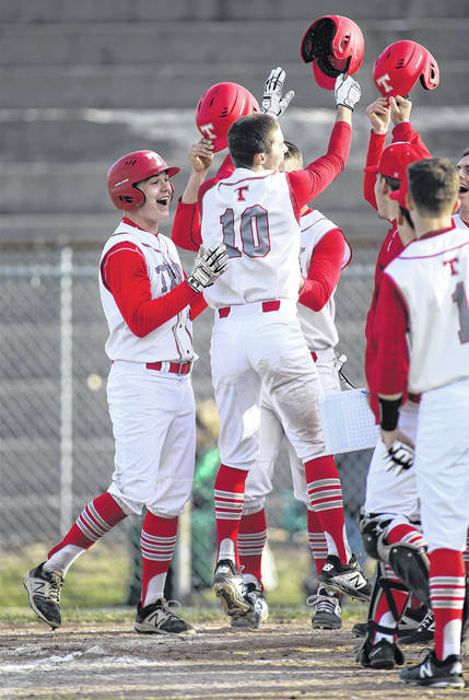 Lee Woolery Miami Valley Today Troy's Cole Brogan (10) leaps onto home plate after hitting a grand slam in the fourth inning of Tuesday's 15-0 victory over Greenville at Market Street Field.