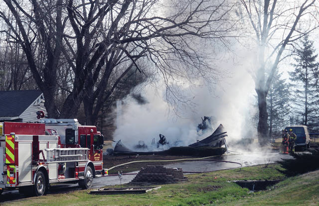 Mike Ullery | Miami Valley Today Firefighters from multiple departments battle a blaze that leveled a garage in the 7000 block of Kessler-Frederick Road on Tuesday morning.