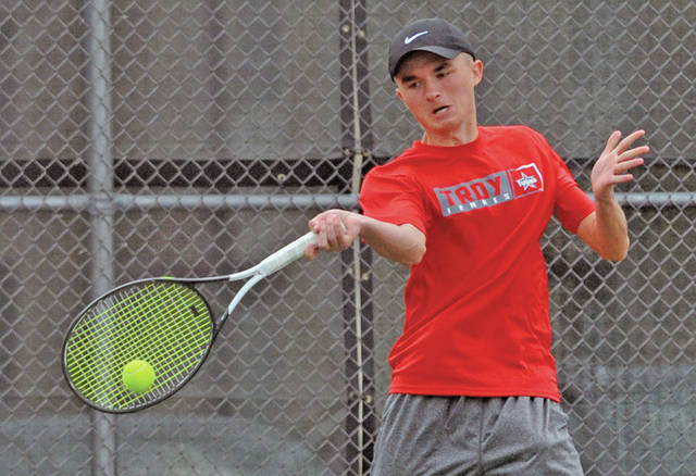 Josh Brown|Miami Valley Today Troy's Nathan Kleptz hits a forehand at first singles Wednesday against Tecumseh.
