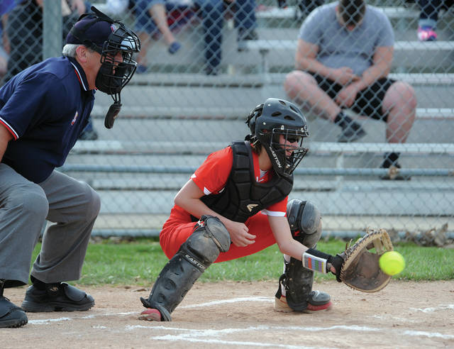 Piqua catcher Kylie Trissell works behind the plate against Northeastern on Thursday.