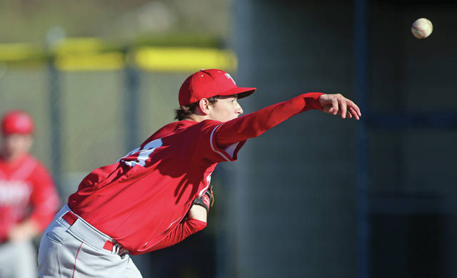Lee Woolery|Miami Valley Today Troy starter Ethan West delivers a pitch Monday against Miami East at Miami East High School.