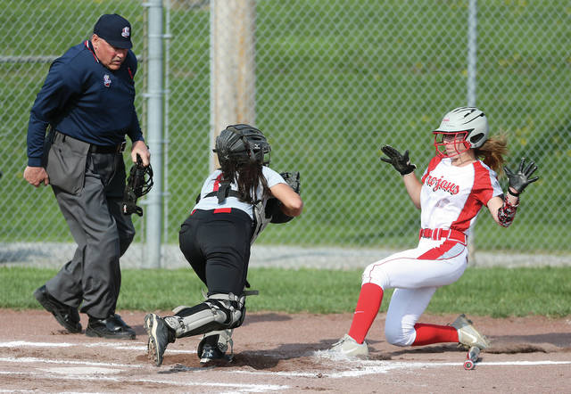 Lee Woolery|Miami Valley Today Troy's Megan Malott slides in safely at home Thursday against Stebbins at Market Street Diamond.