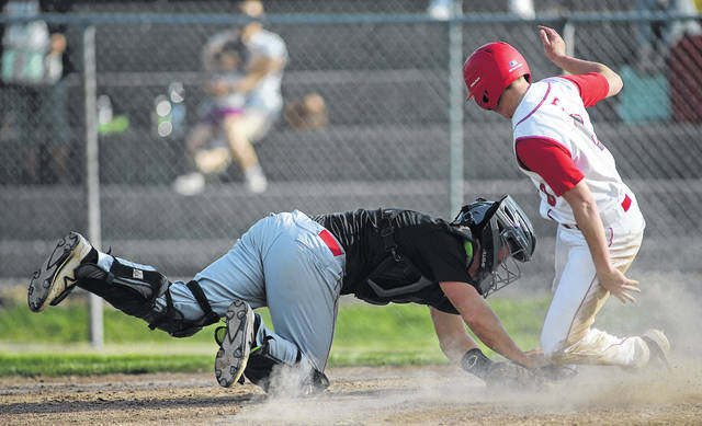 Lee Woolery|Miami Valley Today Tippecanoe catcher Cade Beam tags out Troy's Nathan Henderson at home plate in the fourth inning Monday at Market Street Field.