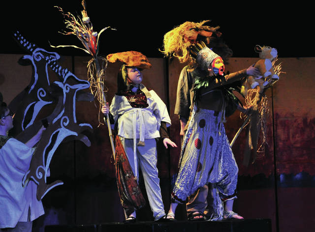 Rafiki, played by eighth-grader Savannah Cox, front right, along with cast members perform a scene from this year's Piqua Junior High School Music Department production of Disney's The Lion King during a dress rehearsal on Tuesday. The performance will be held at PJHS on Thursday, April 25, at 7:30 p.m.