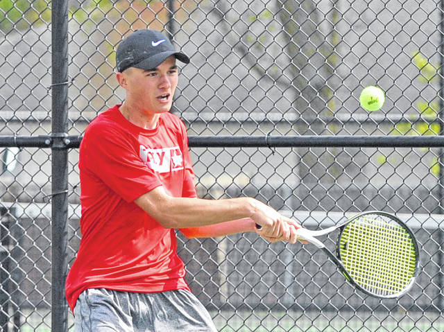 Josh Brown|Miami Valley Today Troy's Nathan Kleptz chases down the ball at first singles Friday at Tippecanoe.