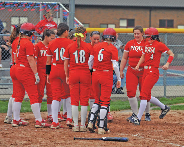 Josh Brown|Miami Valley Today Piqua's Reagan Toopes (4) is greeted by her teammates at home plate after hitting a two-run home run Monday against Troy.