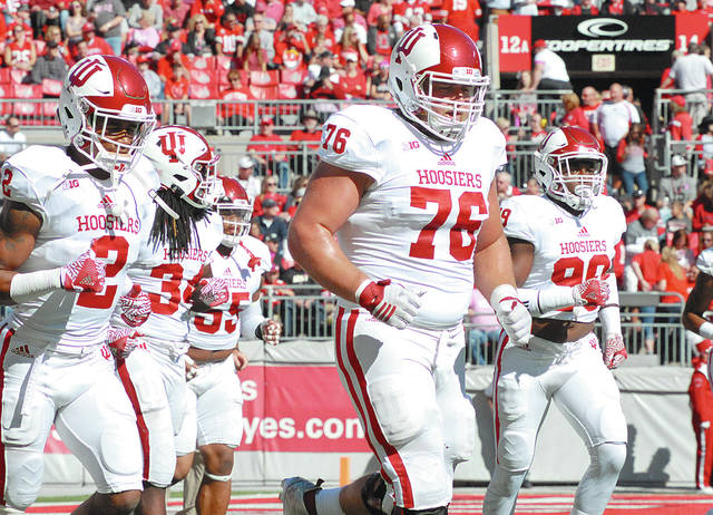 Anthony Weber|Miami Valley Today file Indiana University's Wes Martin (76) warms up with his teammates before a game against Ohio State during the 2016 season at Ohio Stadium. Martin, a Milton-Union High School graduate, will be eligible for this weekend's NFL draft.