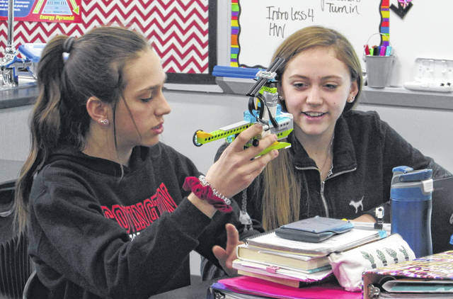 Sam Wildow | Miami Valley Today Covington students Taylor Roth (left) and Lillian Hughes (right) demonstrating a helicopter drop and rescue LEGO robot on Thursday.