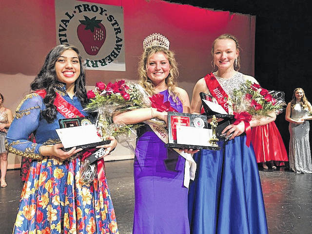 Melanie Yingst | Miami Valley Sunday News file photo From left, first attendant Krishna Brucia, Queen Brooke Klopfenstein and second attendant Cassidy Poland, were named the Queen's court for the 2018 Troy Strawberry Festival last year.