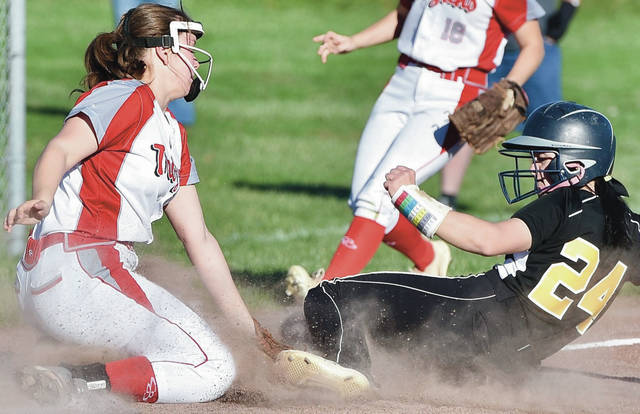 Luke Gronneberg|AIM Media Sidney's Naida Stephens slides safely into third just ahead of the tag by Troy's Lilly James at Troy on Tuesday.