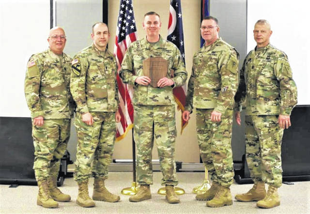 Provided photo SFC Aaron Weaver, center, stands with, left to right, CSM Steven Stormes, LTC David Swisher, Col. Daniel Shank, and CSM Roger Jones during his induction into the Ohio Army National Guard Recruiting Hall of Fame on Monday, April 1 in Columbus.
