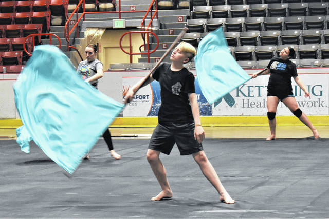 Cody Willoughby | AIM Media Midwest Members of the Northwest Cabarrus High School color guard team, of Concord, N.C., conduct flag drills during rehearsal on Wednesday at Hobart Arena.