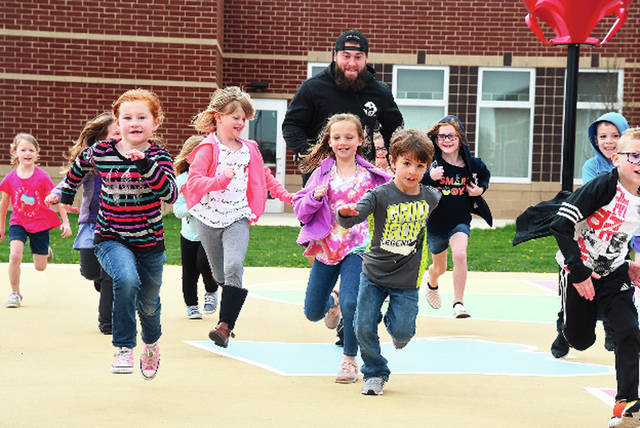 Ben Robinson|GoBuccs.com Former Covington and Ohio University standout A.J. Ouellette hangs out with Covington Elementary School students Wednesday.